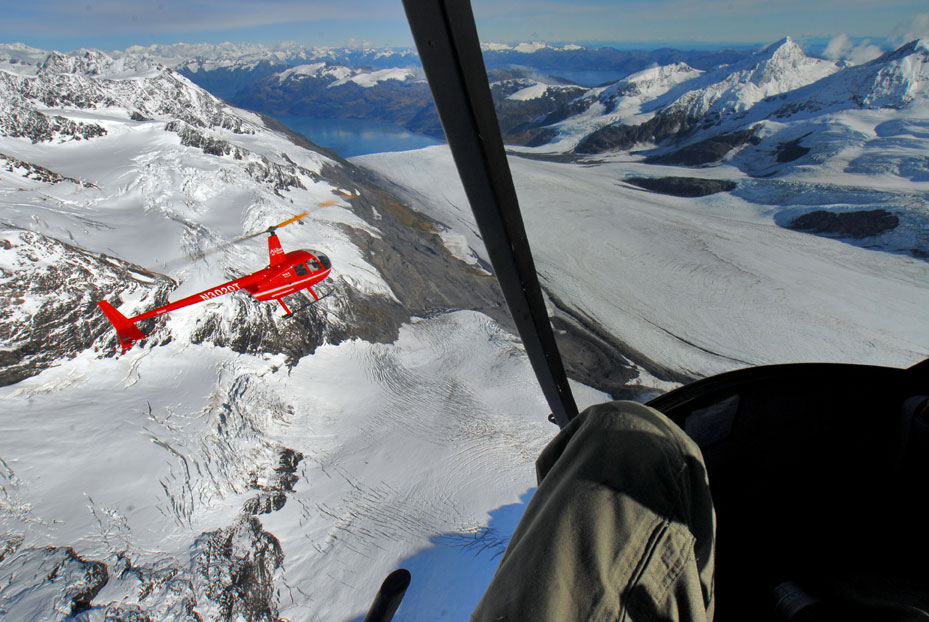 In an R44 Raven II, shooting a second R44 over the Chugach Mountains, Alaska