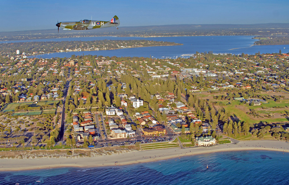 Spitfire Mk26 over Cottesloe and Indiana Cafe