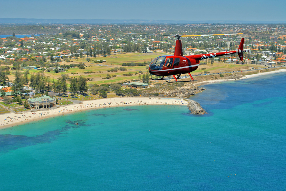 Robinson R44 Raven II, over Cottesloe and Indiana Cafe