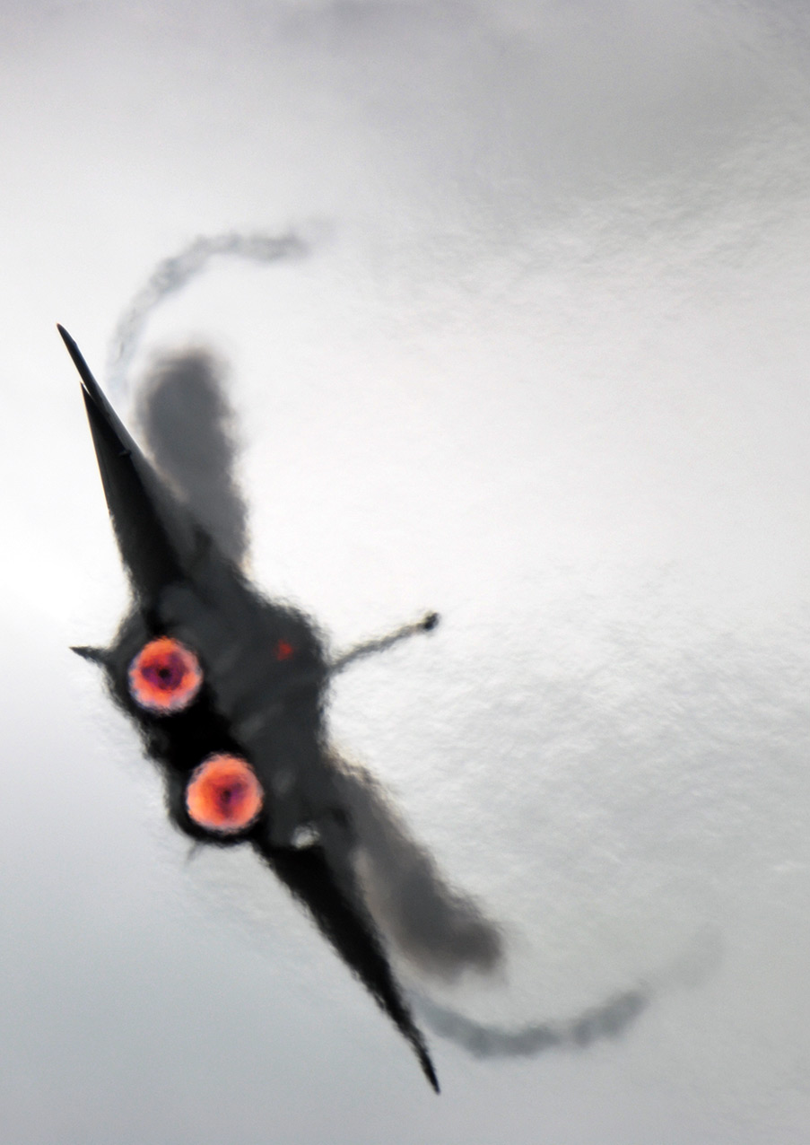 An RAAF F-111C turning with full afterburners, showing the efflux