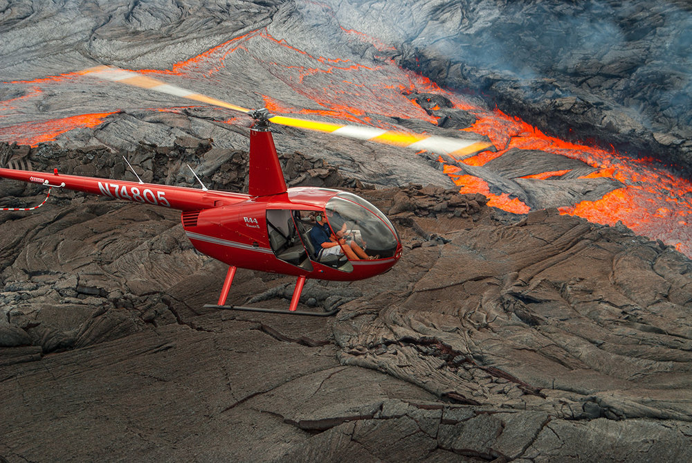 Robinson R44 helicopter over the Kiluaea lava flow, Hawaii