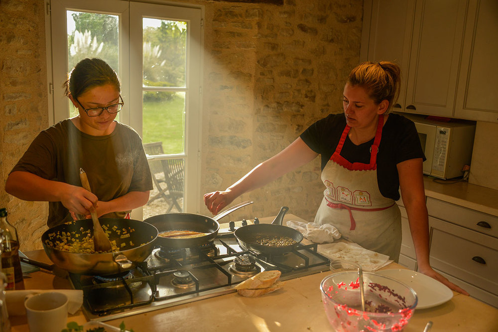 Chefs Lilly (left) and Tess (right) at work in the La Borie Grande kitchen
