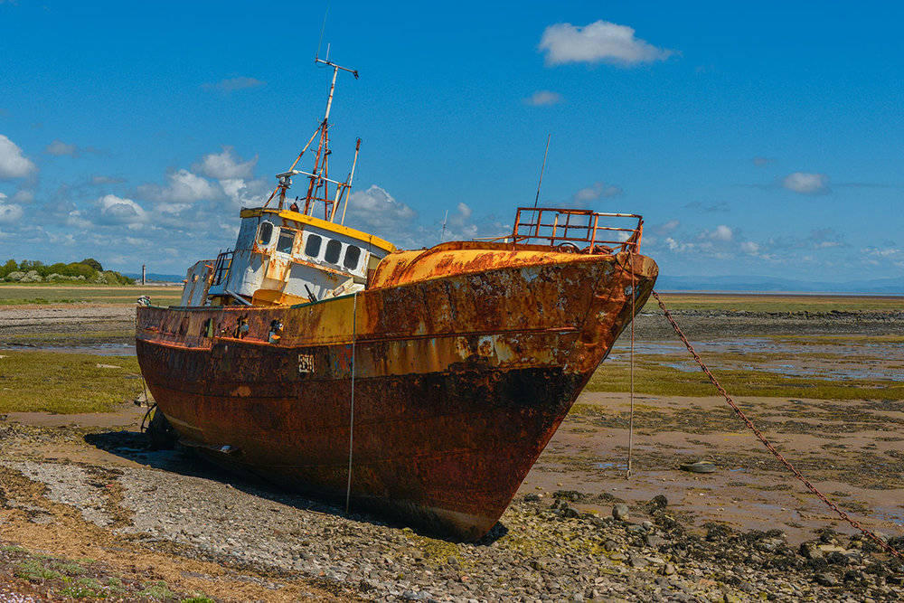 Abandoned fishing trawler, Roa Island causeway, Cumbria.