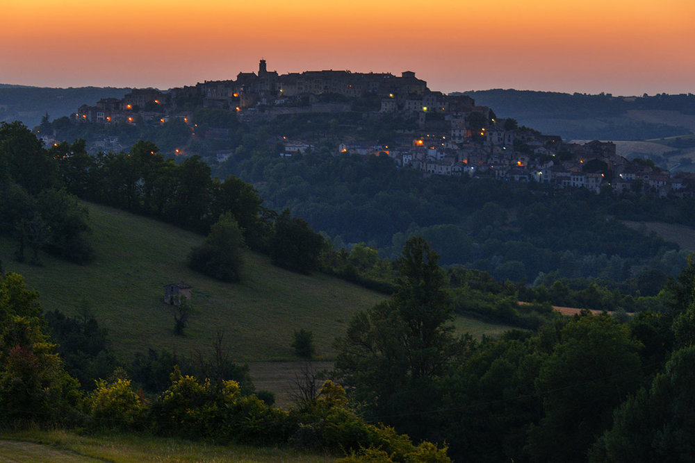 Sunset over Cordes seen from the nearby hamlet of Sarmazes