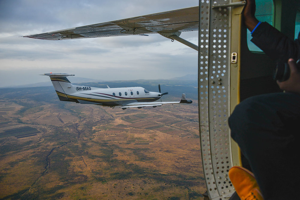 PC12 over Tanzania, taken from a Cessna Caravan from Coastal Aviation.