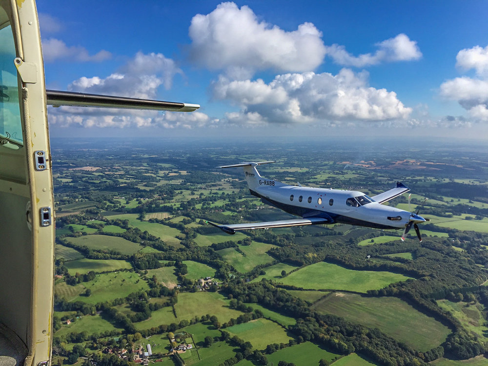 Shooting a PC12 from Oriens Aviation over Kent, UK. Taken from a Cessna Caravan (G-EELS).