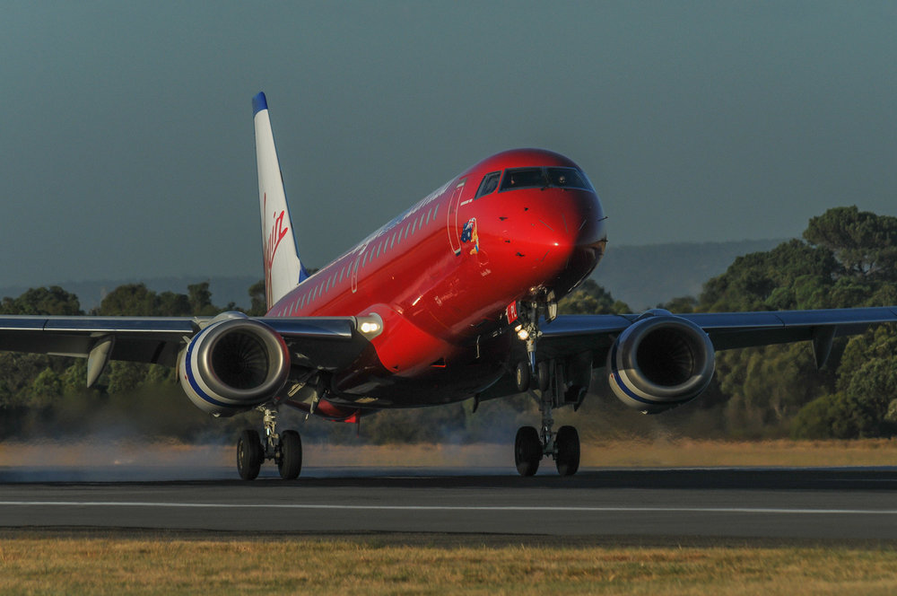 A Virgin Blue Embraer 190 touching down
