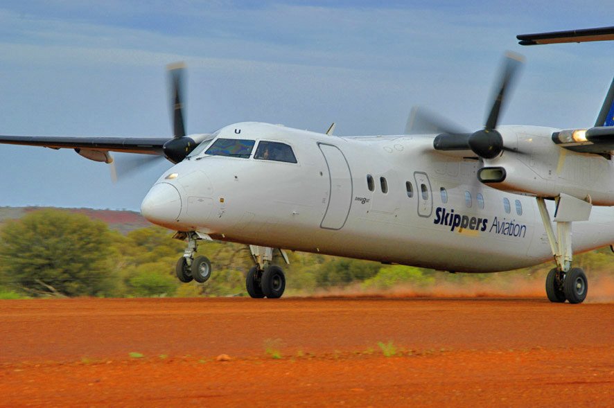 Skippers Aviation Dash-8 lifting off from an outback mine site