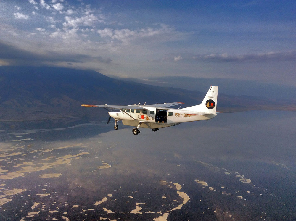 Jon in a Coastal Aviation Cessna Caravan, over Lake Natron. Photo by Coastal Aviation