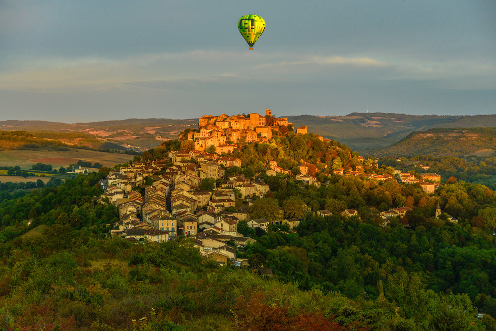 September 2018. Sunrise over Cordes with balloon.