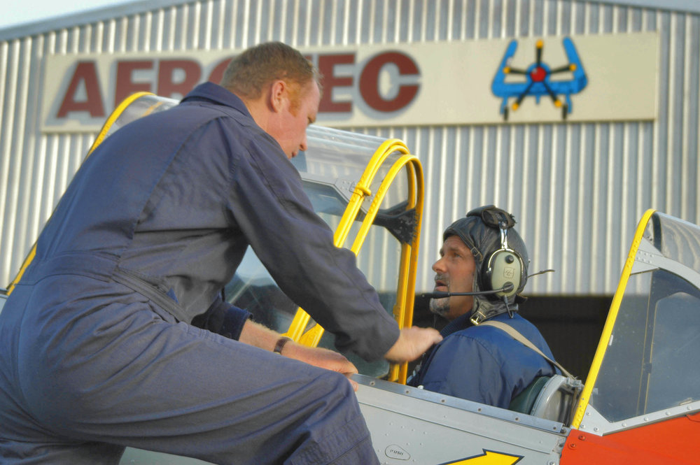 Aerotec pilot Matt Handley and myself (seated) having a last minute shoot briefing in the T6 Texan.