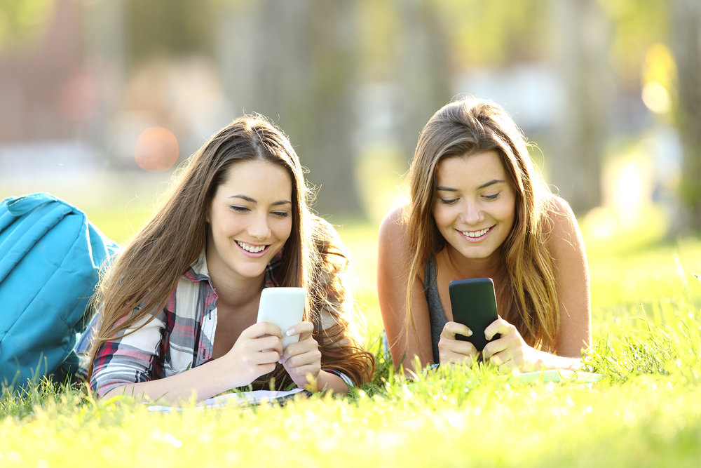 bigstock-Two-Students-Texting-In-Their--196020685.jpg