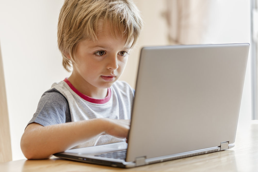 bigstock-Young-boy-working-on-laptop-co-96285710.jpg