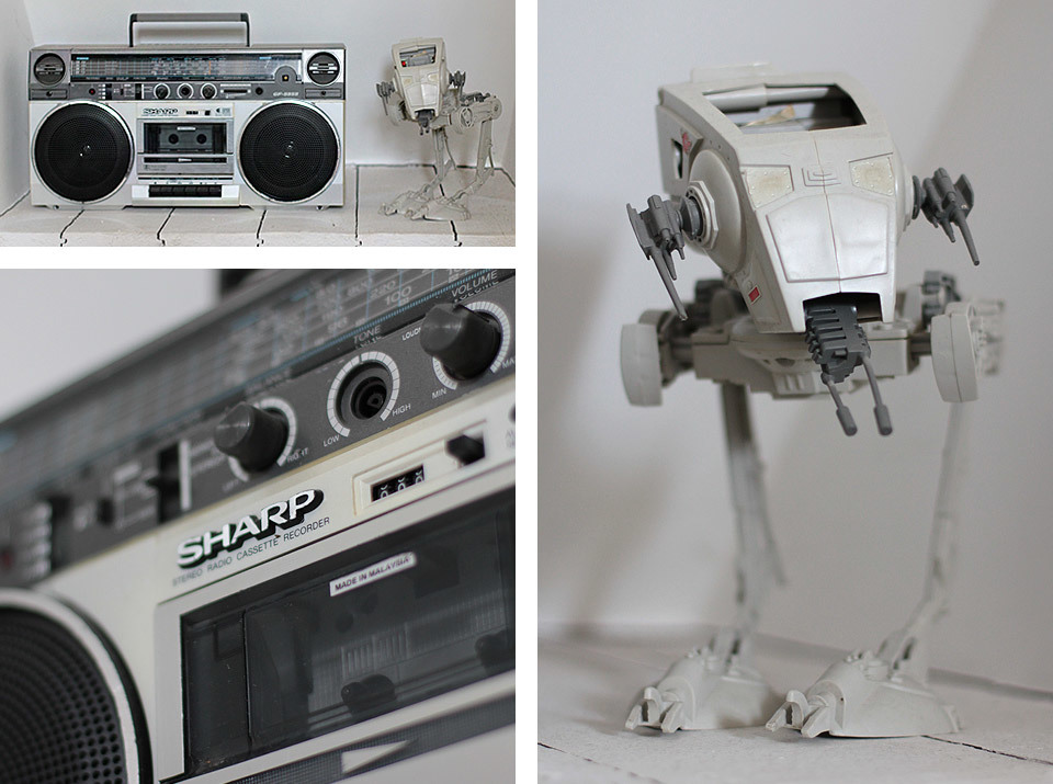 These greet me at the top of the stairs when I walk down to my home office - and were 2 of the first things I moved in when we bought the house. Sharp Ghettoblaster and Star Wars* AT-ST. I have since acquired another 2 AT-ST's and several figures, as I never had any when I was growing up. Simon and Peter Burgess, who lived opposite us had them all! *yes, I know, technically it's from 'Return of the Jedi', but it's from the Star Wars universe ;)