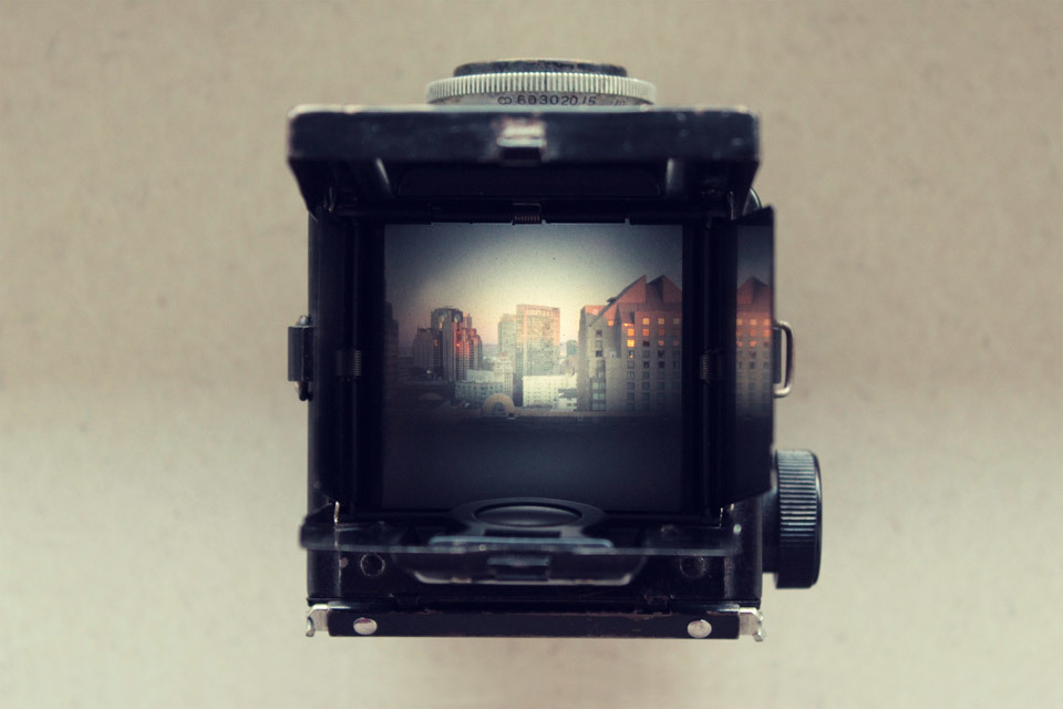 Argoflex TLR camera with San Francisco skyline.
