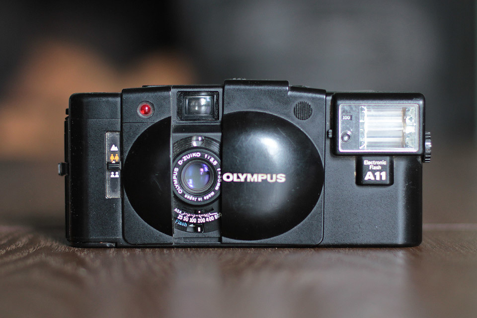 Olympus XA2 with A11 Flash unit. The XA2 uses 'zone' focusing - which means it has 3 settings, with bracketed distances. Portraits 1.2-1.8m; Groups 1.2-6.3m; Mountains 6.3-infinity.  The Olympus XA (the better model) was famously used by  Terry Richardson .