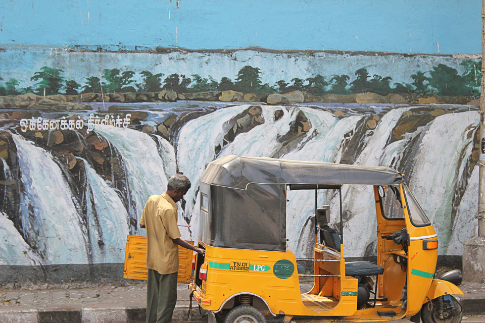 Wall painting and Rickshaw driver in Chennai, India.