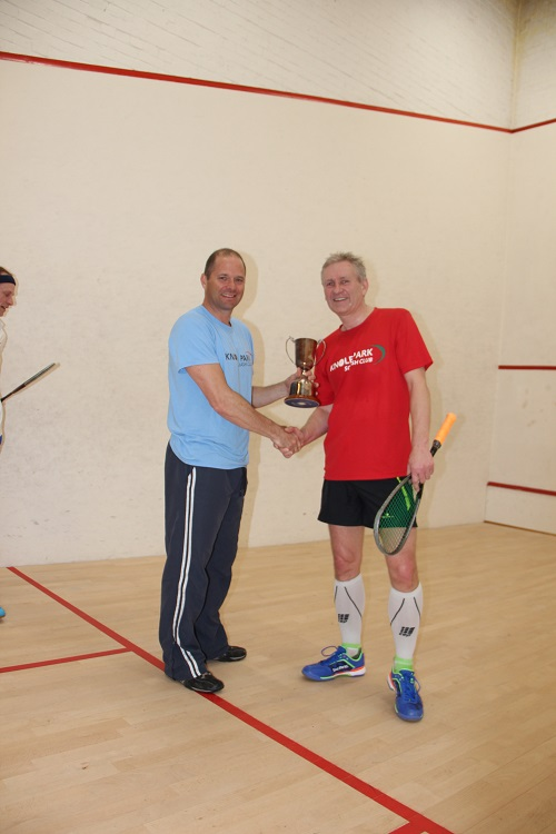 Then hands the sparkling Champions trophy to David Falconer.