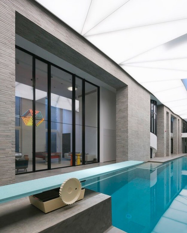 Project London showcasing its 6ft Pivot doors overlooking a beautiful indoor pool! 🏊  To see more please visit http://vitrocsa.co.uk  PROJECT LONDON  Architect: @23_arc  Photography:  Vitrocsa Product: Vitrocsa Pivot Door. 
