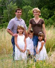 Family with children in a field.