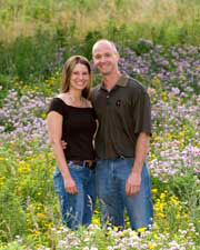 A couples portrait in a flower field.