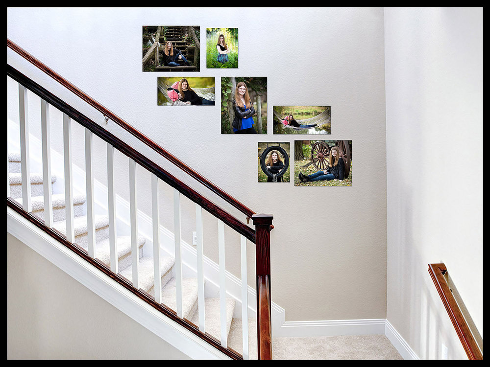 Senior portraits displayed over staircase.