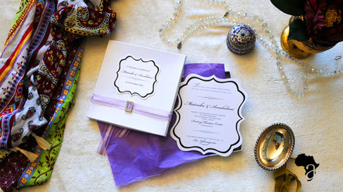 Invitation in a box  This invitation is shaped like a vintage frame and packaged in a square box. The box is lined with tissue paper and then wrapped with a ribbon and name card. Box size : 180mm X 180mm   Price range : R70 - R95    *Please note that we design according to our clients specific color scheme and theme. All invite folds can be customized to best reflect your wedding day or big event.