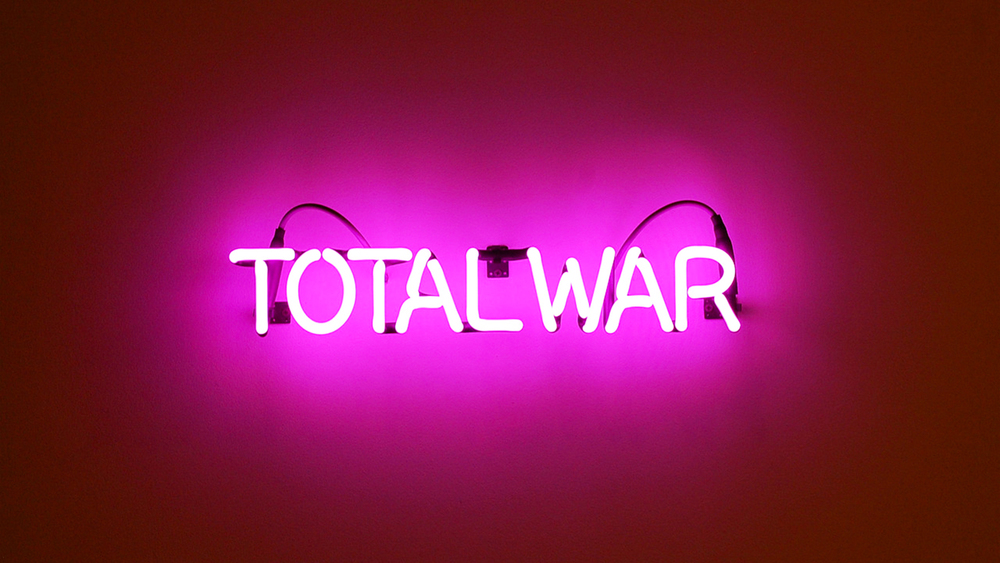 TOTAL WAR: Neon, glass, transformer, GTO, supports, silver, zip ties, cinder block, 32 in. x 1 in. x 5 in. | Dylan Neuwirth © 2011
