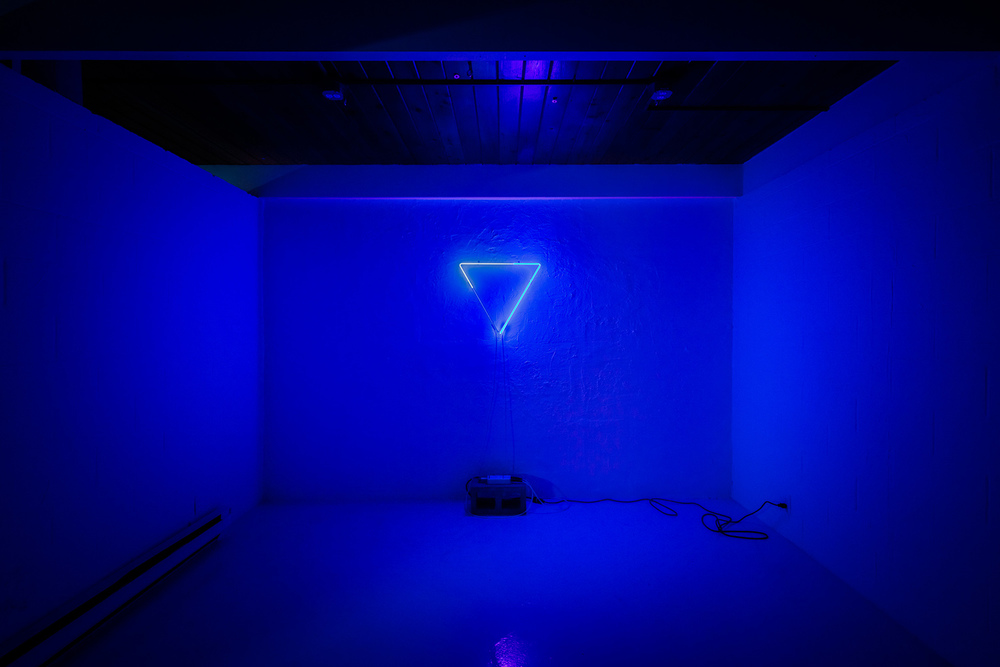 NOT-A-HOLOGRAM_ISOLAR.MMXVI: argon, glass, nickel, one transformer, extension cord, concrete block, 24 in. x 12 in. x 72 in. | Dylan Neuwirth + Image by Nathaniel Willson © 2016