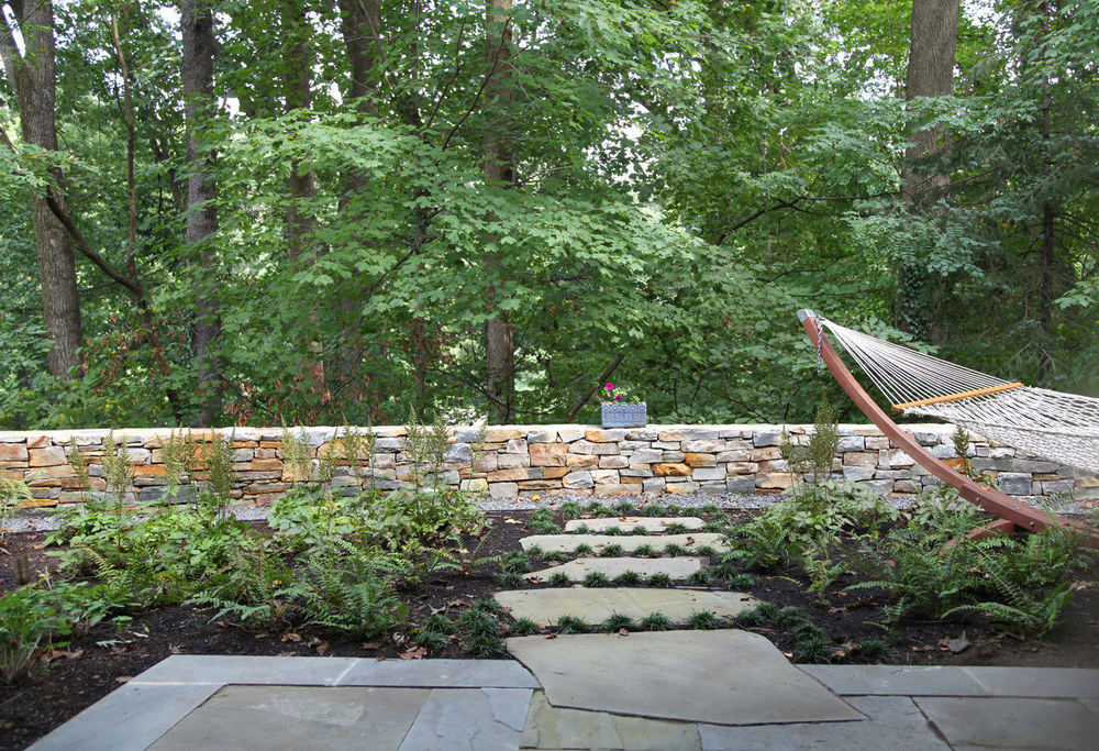Project Location:  Arlington, VA   Completion:  Spring 2012  General Contractor:  Redux Garden & Home  Primary Material Palette:  full range natural cleft bluestone, select blue thermal finish bluestone, Maryland fieldstone, Bull Run brown and tan stone  Photos By:  Moody Landscape Architecture (unless noted otherwise)
