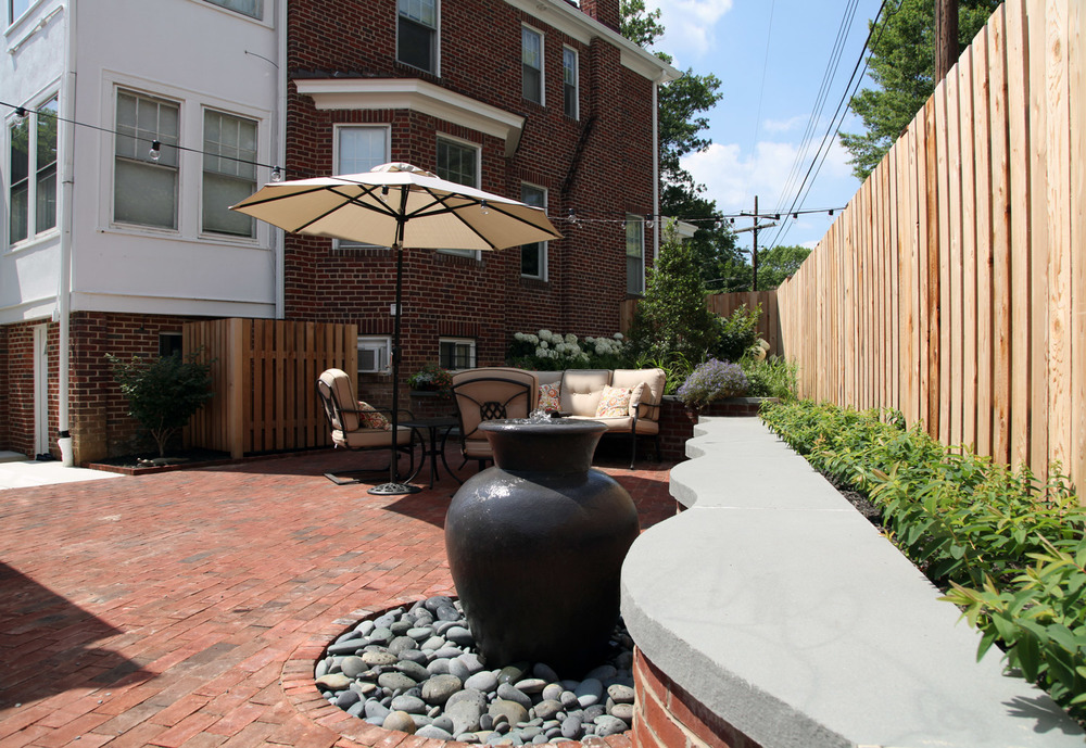 Project Location:  Washington, DC (Friendship Heights)  Completion:  Spring 2014  General Contractor:  Redux Garden & Home  Primary Material Palette:  brick, thermal finish select blue bluestone, Lunaform fountain, blue chip gravel, western red cedar, copper, concrete  Photos By:  Moody Landscape Architecture