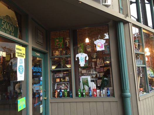 Monster Art & Clothing is located in Old Town Ballard, on the corner of Ballard Ave and 20th in Seattle.