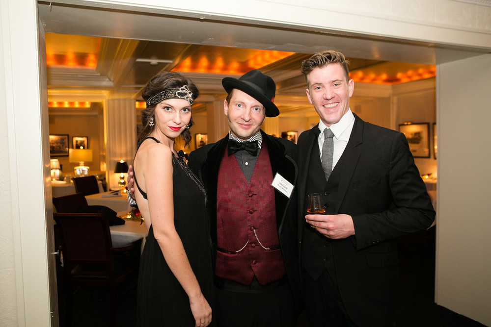scene from Puttin' on the fitz 2015: Scott and Zelda, joined by Fitzgerald in Saint Paul Board Member, Joel Pace. Photo Courtesy of Lisa Venticinque.  More photos from this unforgettable event can be found By clicking here.