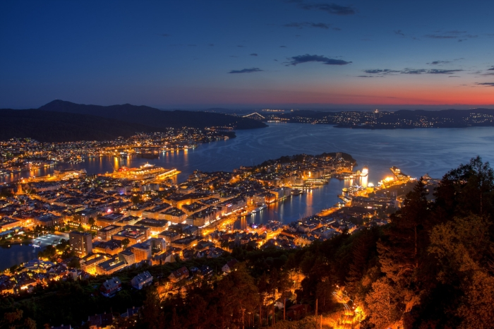 Night view from Mount Floyen by Sergey Ashmarin licensed under CC BY-SA 3.0 . The city is surrounded by mountains and therefore known as the city of seven mountains.