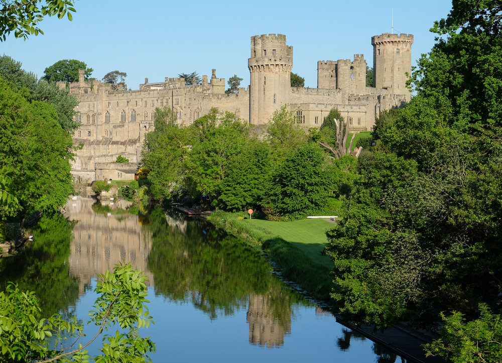 """ Warwick Castle "" by  DeFacto , licensed under CC BY-SA 4.0 ( https://creativecommons.org/licenses/by-sa/4.0/deed.en ). A medieval castle built in 1068 in Warwick, England."
