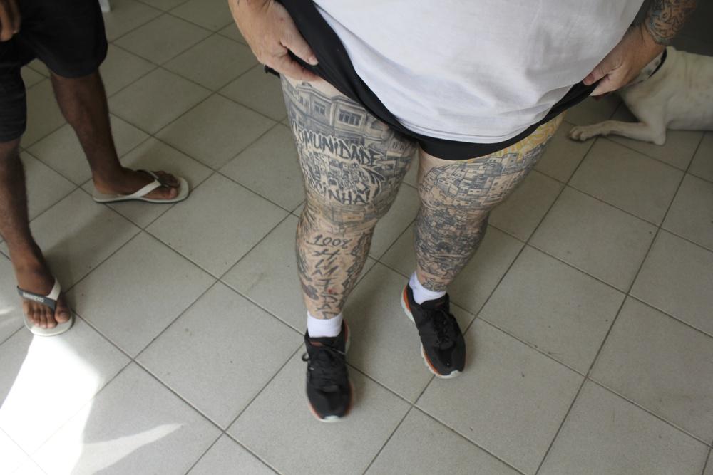 DJ Zezinho's tatooed legs