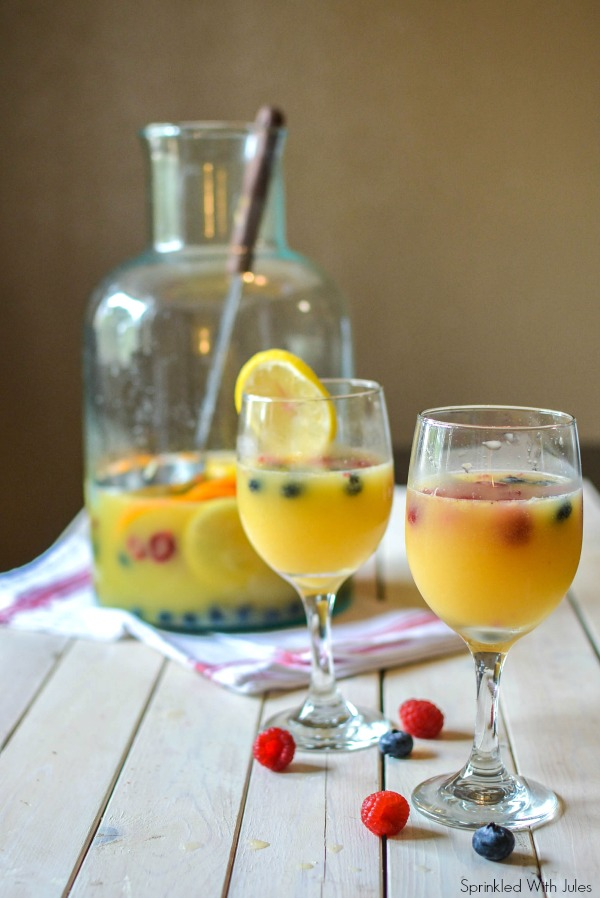 Mimosa Sangria. The perfect way to drink champagne this New Year's. / Sprinkled With Jules