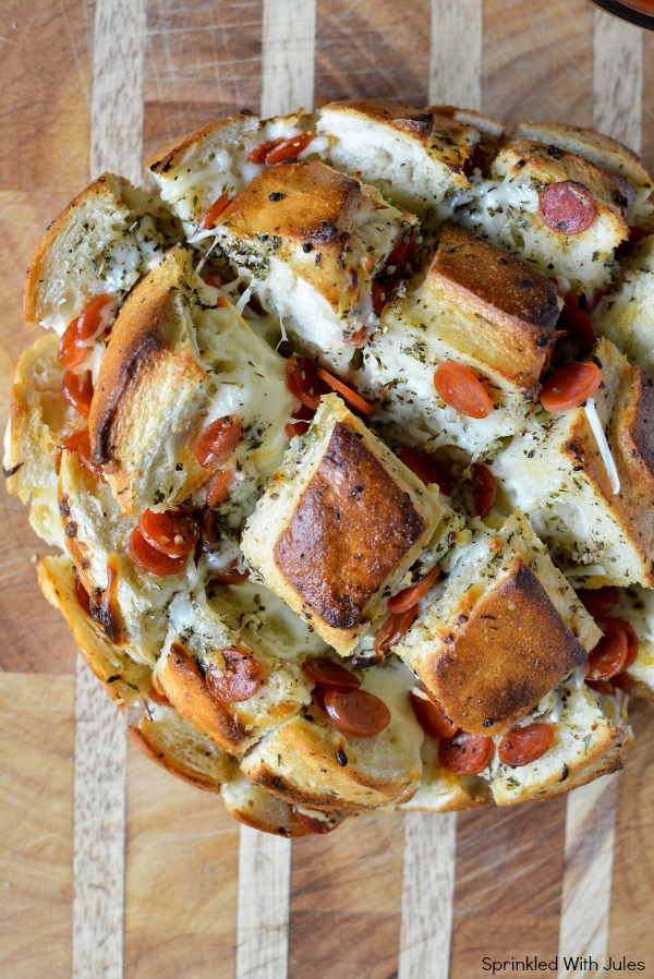 Sourdough Pull Apart Pizza Bread. Easy, cheesy, and delicious with garlic herb butter. #gameday / Sprinkled With Jules