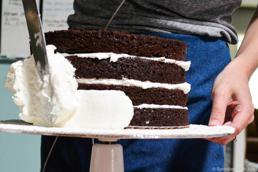 Step-by-Step photos and video of stacking and crumb coating a layer cake.