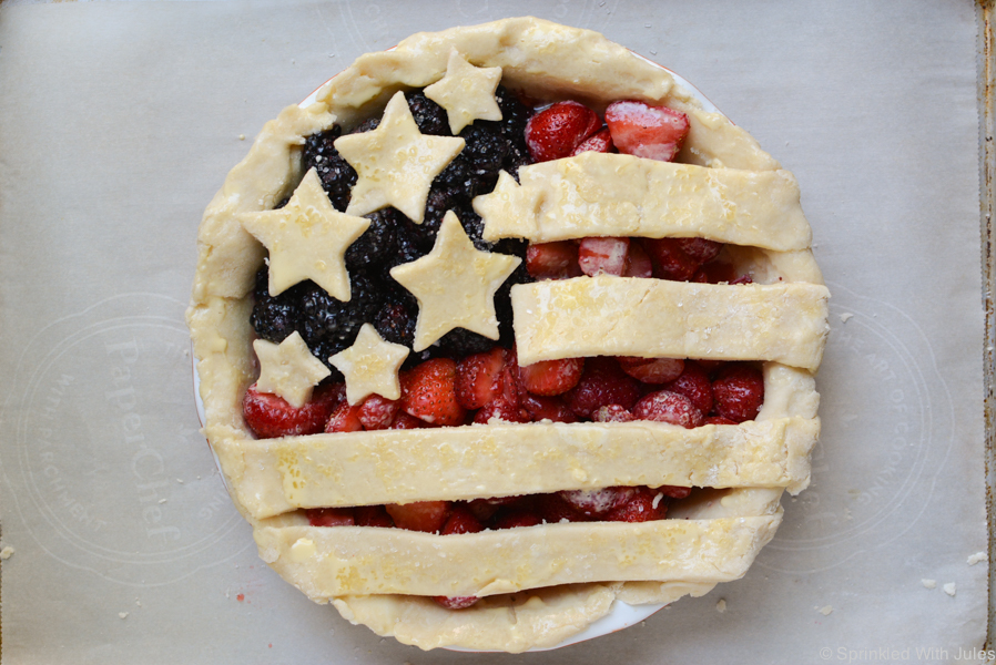 patriotic american flag pie with blackberries and strawberries.