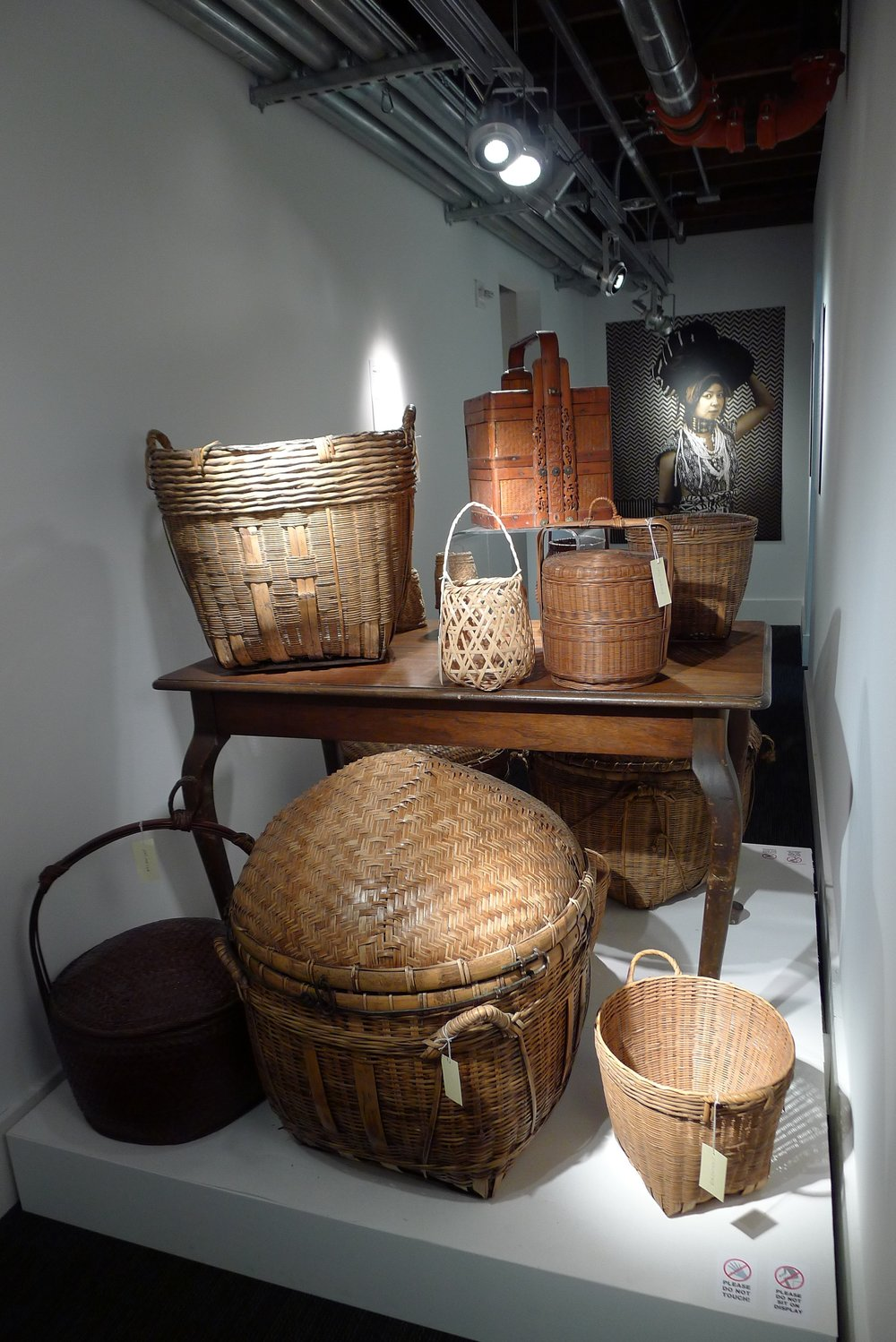 Stephanie Syjuco's  Cargo Cult Series  juxtaposed with baskets from the Wing Luke Collection
