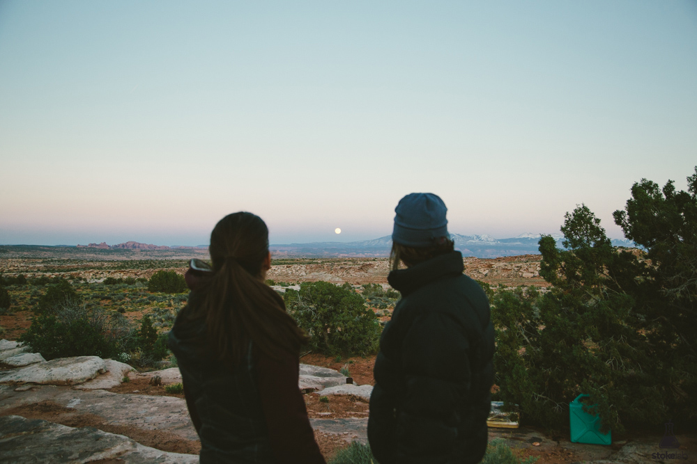 Lori Horn and Mandy Thompson watch the moonrise over the La Sals.