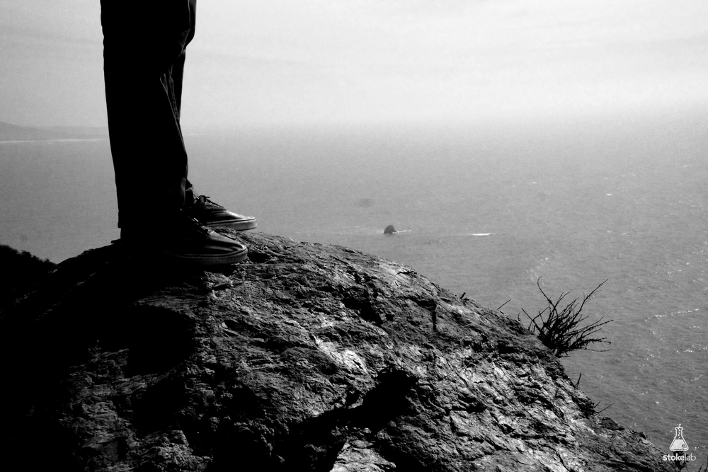 Neal insisted on climbing out on this rock, as if the extra two feet made the 2,000 foot-high view better.