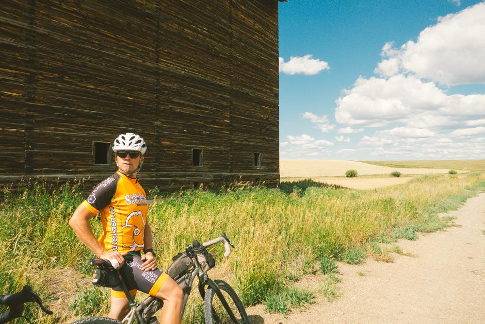 JP framed by an abandoned barn.