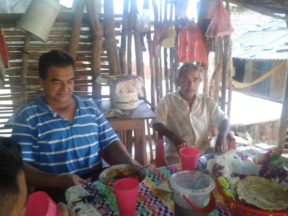 Norberto, left, and the pastor, eating at a home in  La Hierba Santa