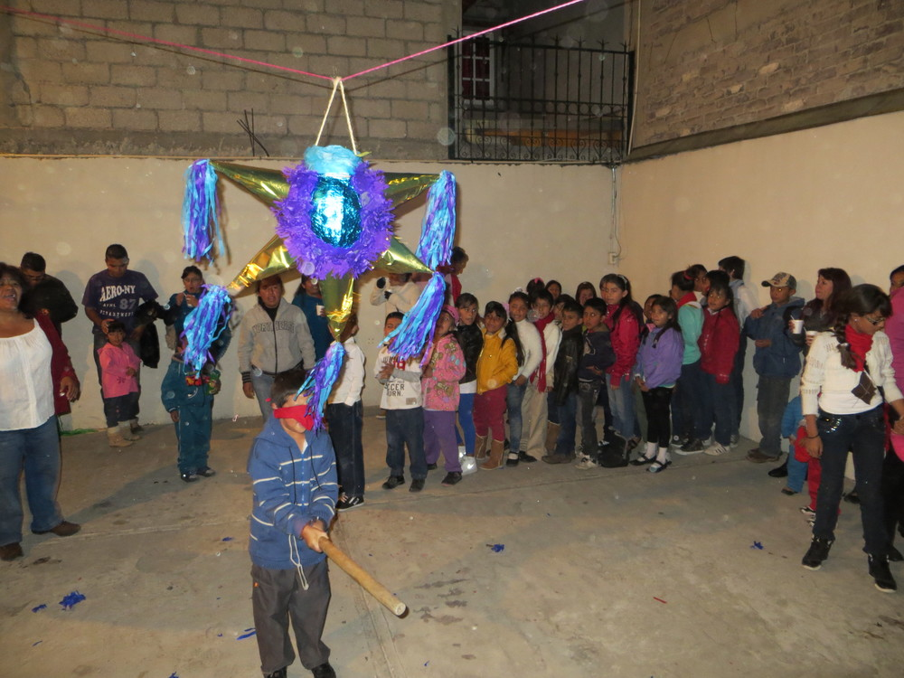 After the Christmas services there were multiple piñatas for the many kids to break open.