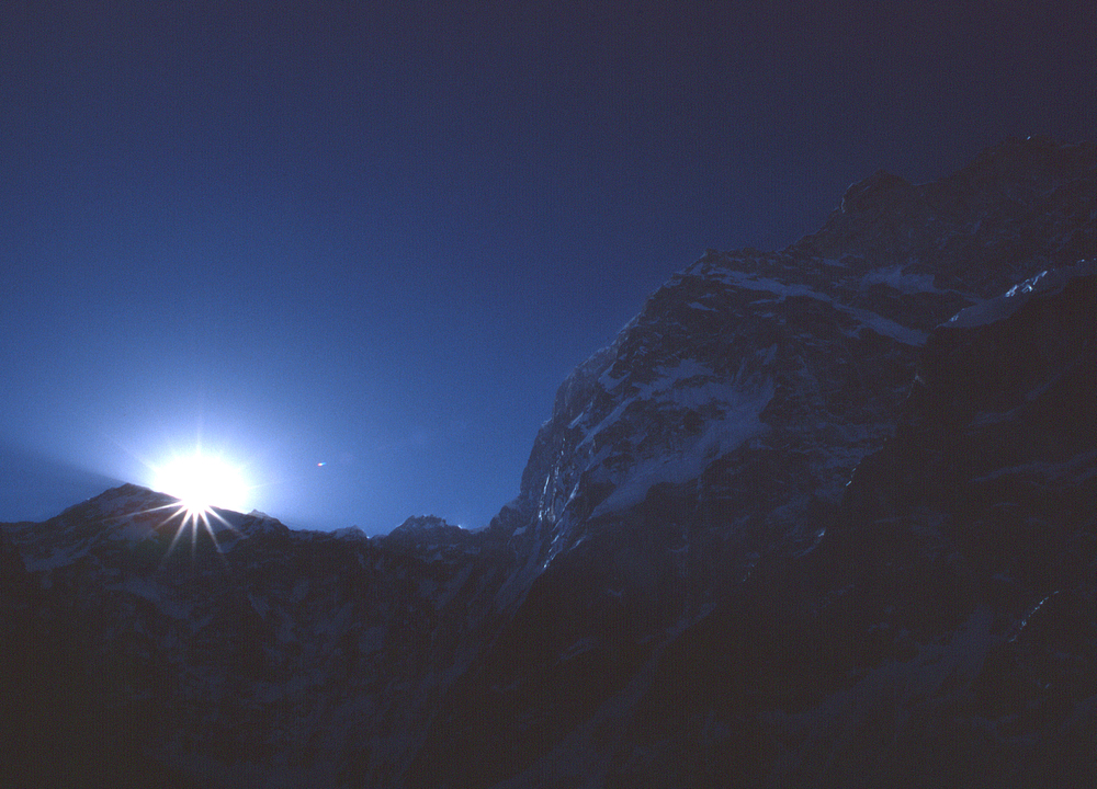 Dawn at base camp (4700m), under the massive north face.