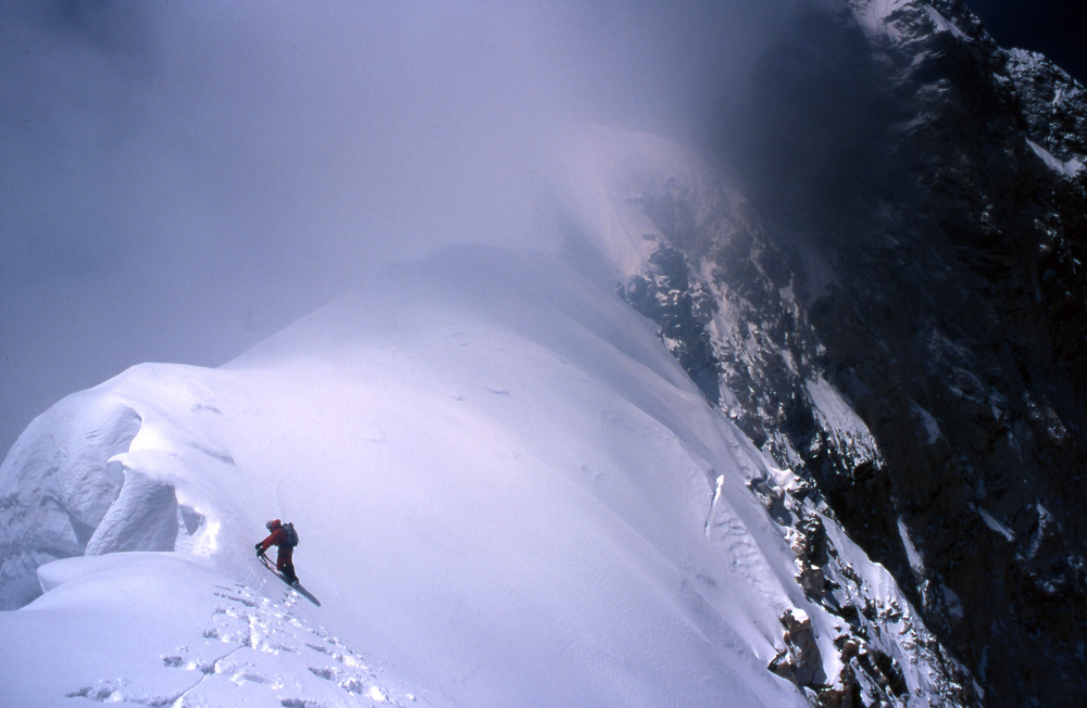 Pushing along and up the summit ridge into bad weather at ca. 7400m.