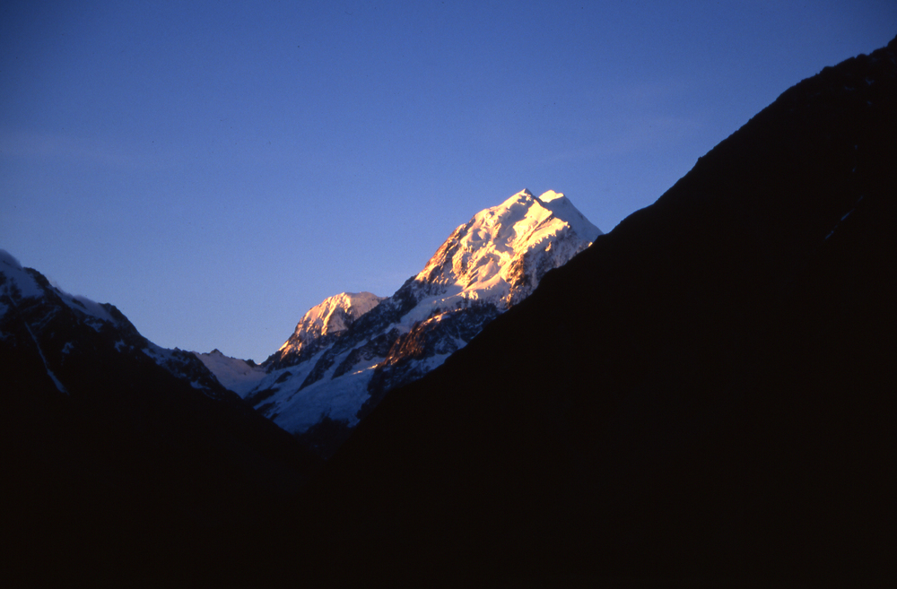 Mt. Cook showing the low, middle and high peaks, and Mt. Hicks (left) from the south/village, 1998.