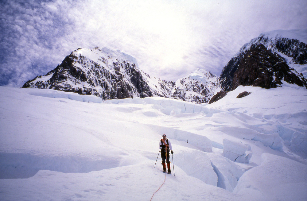"Walking out after a trip up to ""Mother Empress,"" summer 1996. L to R: Mt. Hicks south face, Mt. Dampier, Mt. Cook's Sheila and Hooker faces. Empress Hut is on the rocky outcrop directly beneath Green saddle (the col between Dampier and Cook)."